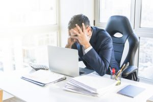 stressed-young-businessman-sitting-workplace